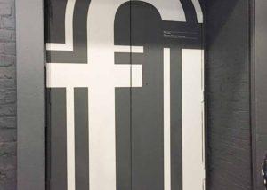 Monotype doorway signage