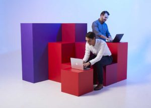 Models amongst vividly coloured cubes for Foehn photoshoot